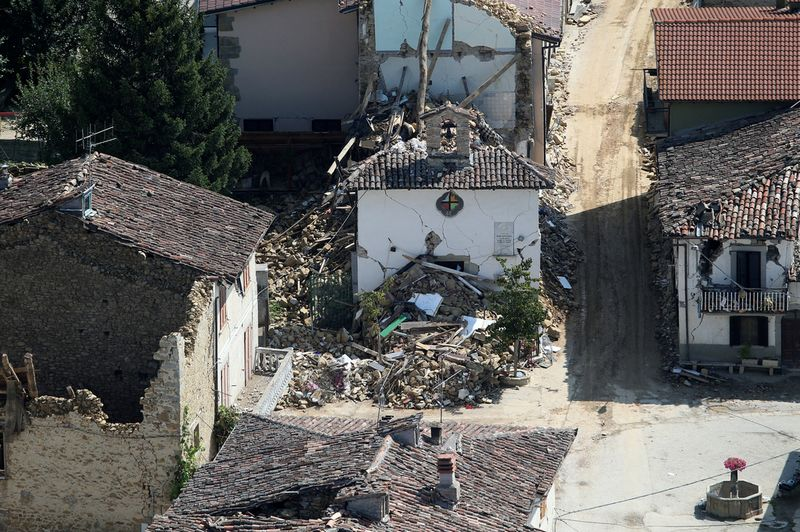 A chapel and collapsed houses are seen in a small village near Amatrice after earthquake that levelled central Italy, September 1, 2016. REUTERS/Stefano Rellandini